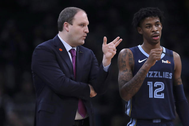 Memphis Grizzlies head coach Taylor Jenkins, left, talks with Memphis Grizzlies guard Ja Morant (12) during a time out in the first half of an NBA basketball game in Boston, Wednesday, Jan. 22, 2020. (AP Photo/Charles Krupa)