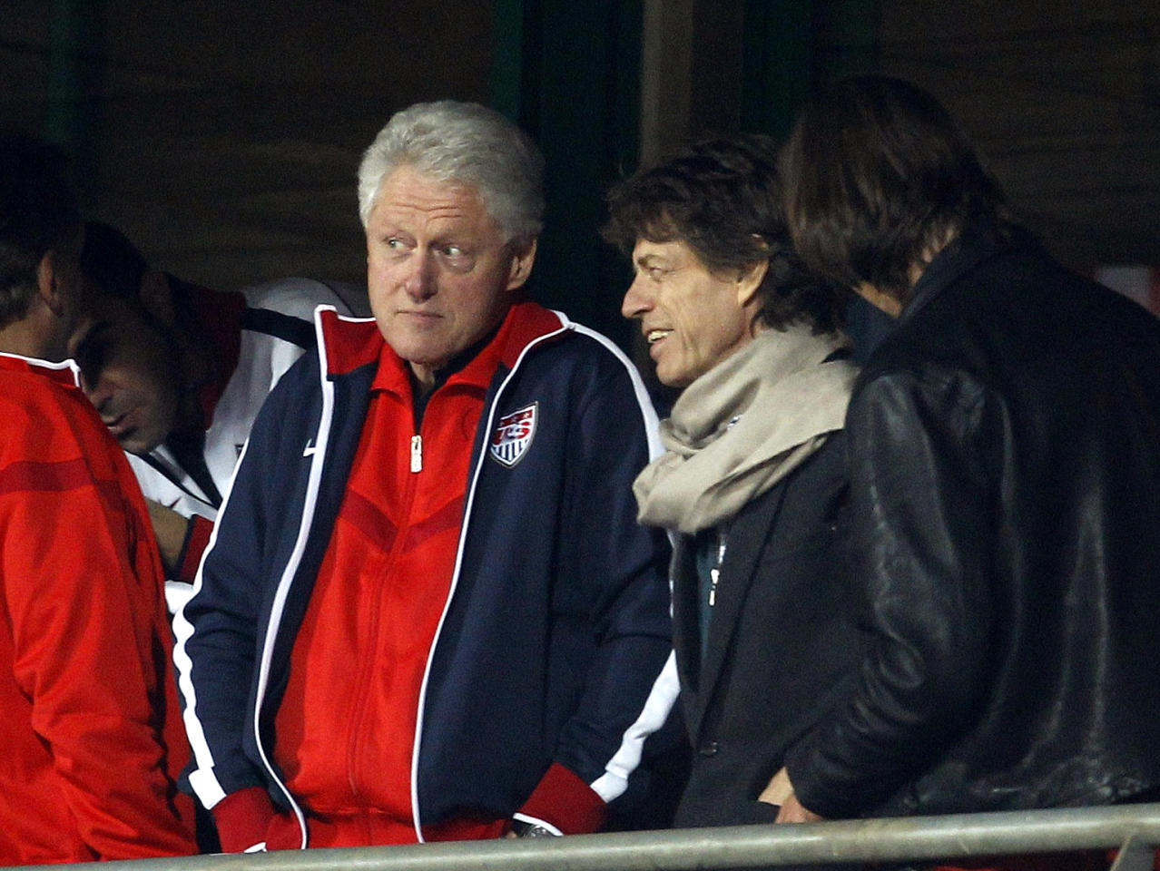 Musician Mick Jagger (2nd R) and former U.S. President Bill Clinton watch the 2010 World Cup second round match between the United States and Ghana at Royal Bafokeng stadium in Rustenburg June 26, 2010. (REUTERS/Brian Snyder)