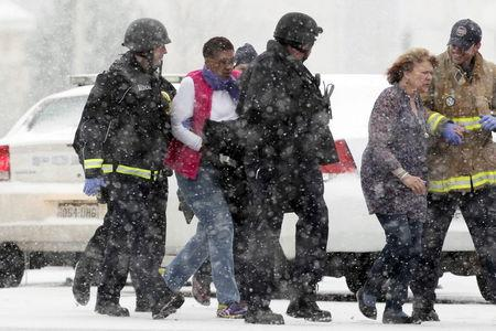 Two women are evacuated from a building where a shooter was suspected to be still holed up in Colorado Springs, Colorado, November 27, 2015, during a snowstorm. REUTERS/Rick Wilking