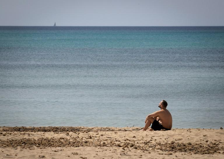There's plenty of room to sunbathe on Mallorca beaches despite an influx of Germans fleeing their country's lockdown restrictions