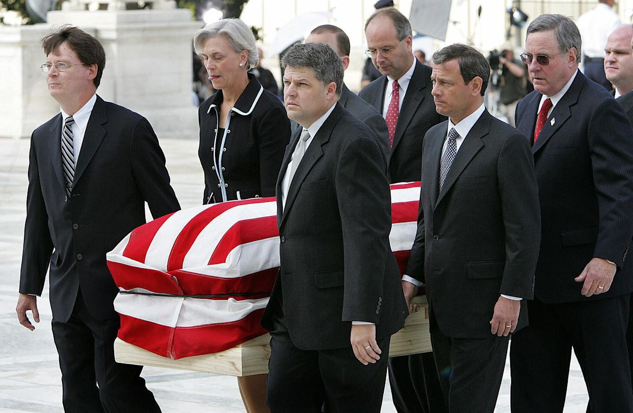 The casket of Chief Justice William Rehnquist is carried by his former court clerks up the stairs of the Supreme Court on Sept. 7, 2005. Second from right is Judge John Roberts, whom President George W. Bush nominated to replace Rehnquist.
