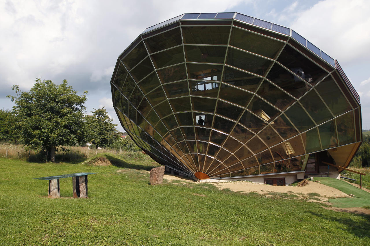 The Heliodome, a bioclimatic solar house is seen in Cosswiller in the Alsacian countryside near Strasbourg, Eastern France, August 4, 2011. The house is designed as a giant three-dimensional sundial, set on a fixed angle in relationship to the sun's movements to provide shade during the summer months, keeping the inside temperature cool, and during Fall, Winter and Spring sunlight enters the large windows as the sun's position is lower in the sky, thus warming the living space.   REUTERS/Vincent Kessler (FRANCE  - Tags: ENERGY ENVIRONMENT SOCIETY) - RTR2PLUX