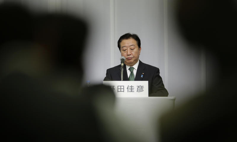 Japanese Prime Minister Yoshihiko Noda reacts during a joint press conference by candidates of the presidential election of Japan's ruling Democratic Party of Japan in Tokyo Monday, Sept. 10, 2012. Noda will face three ruling party contenders in a leadership election later this month that he is expected to win. (AP Photo/Shizuo Kambayashi)