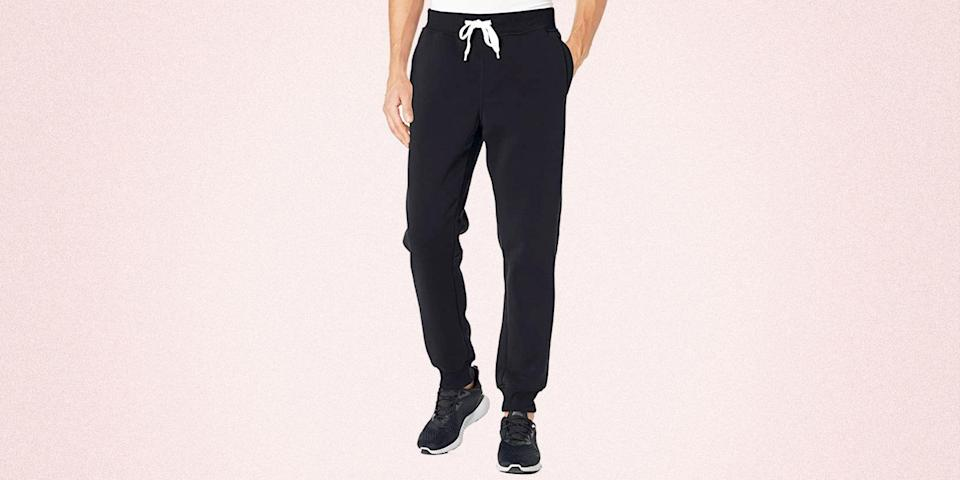 """<p class=""""body-dropcap"""">It's no secret that some days call for sweatpants, but over the last year, it's safe to say that <em>every day </em>called for sweatpants. After shoving our jeans to the back of the closet for longer than planned, joggers have taken over our wardrobe and hey, we're not mad about it. </p><p>Whether you're lounging on the couch, heading to brunch, or hitting the gym, sweatpants have become the new everything pants—so, basically, you can never own enough. And contrary to popular belief (at least back in the day) your sweatpants can actually look polished. If you're heading to a night out, try a tapered silhouette styled with a <a href=""""https://www.esquire.com/style/mens-fashion/g1885/10-white-sneakers-to-wear-right-now-071514/"""" rel=""""nofollow noopener"""" target=""""_blank"""" data-ylk=""""slk:clean white sneaker"""" class=""""link rapid-noclick-resp"""">clean white sneaker</a> and a <a href=""""https://www.esquire.com/style/mens-fashion/g1727/spring-jacket-2014/"""" rel=""""nofollow noopener"""" target=""""_blank"""" data-ylk=""""slk:statement spring jacket."""" class=""""link rapid-noclick-resp"""">statement spring jacket.</a> </p><p>Looking to refresh your lounge collection just in time for the new season? Look no further than Amazon's stockpile of hidden gems. From super affordable finds (starting at just $15) to tried-and-true luxe brands like Alo Yoga and Rhone, these picks will be at your front door in no-time. Shop below and thank us later.</p>"""