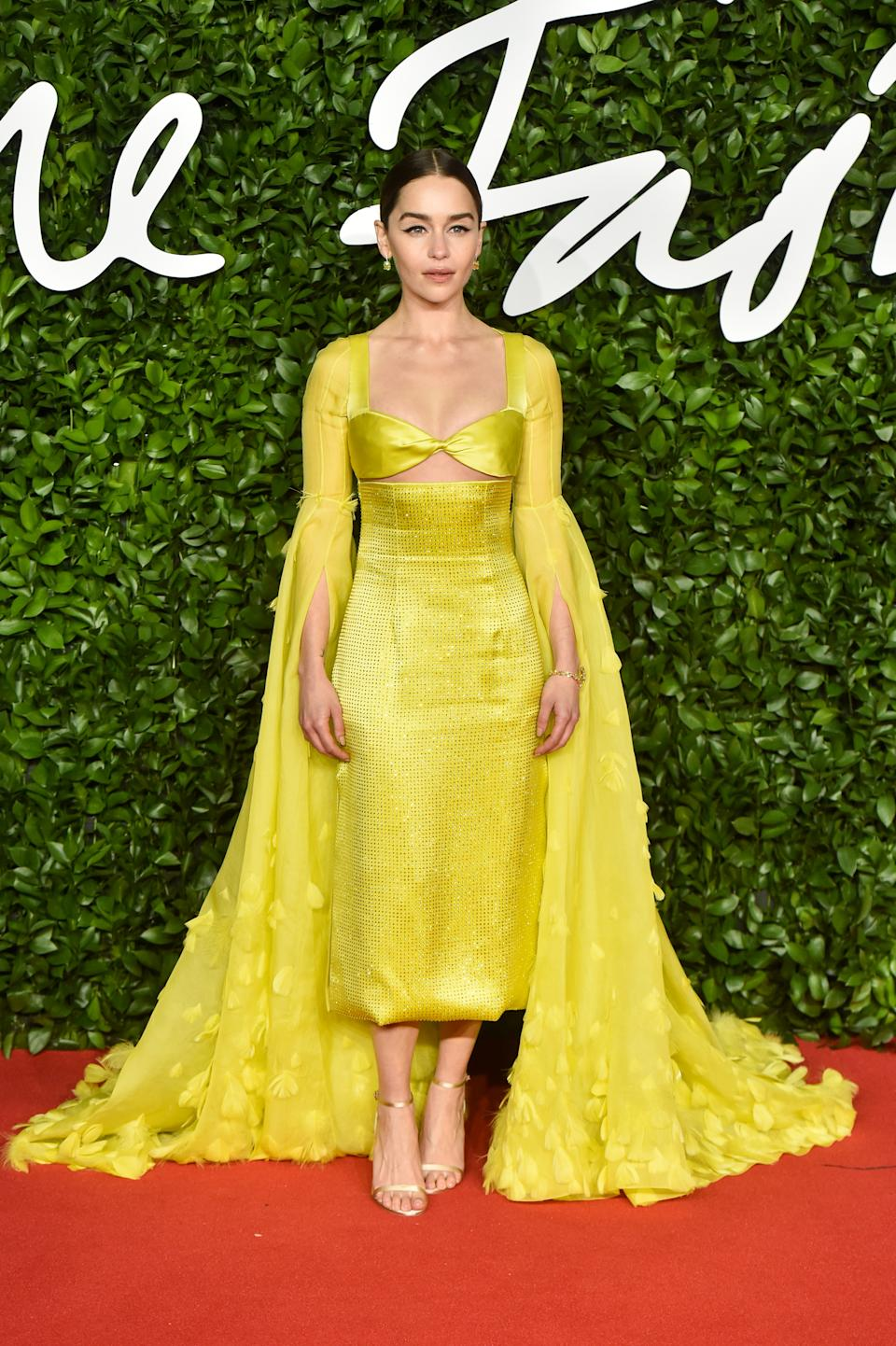 Emilia Clarke wore a canary yellow Schiaparelli gown to present the Isabella Blow Award for Fashion Creator [Photo: Getty]