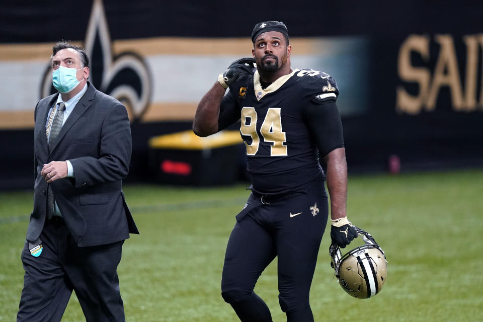 New Orleans Saints defensive end Cameron Jordan (94) walks off the field after being ejected from the game in the second half of an NFL football game against the Kansas City Chiefs in New Orleans, Sunday, Dec. 20, 2020. (AP Photo/Butch Dill)