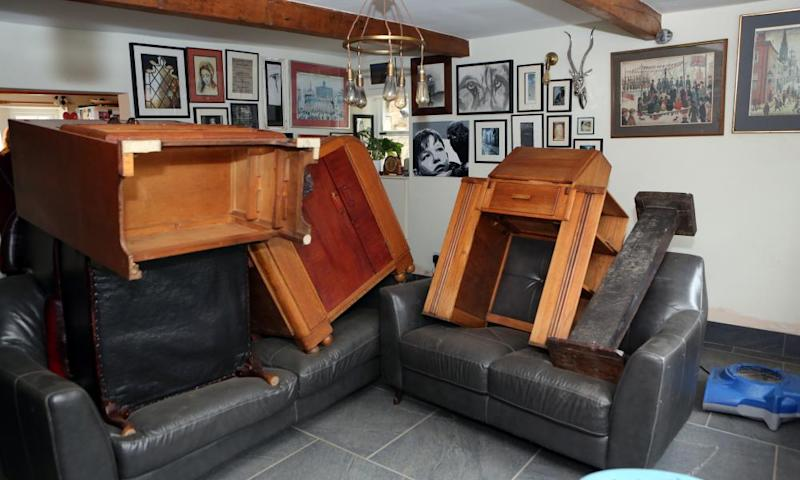 Furniture stacked high to dry out after flooding at Carla Welch's home in Todmorden.