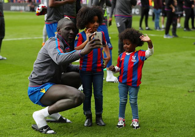 "Soccer Football - Premier League - Crystal Palace vs West Bromwich Albion - Selhurst Park, London, Britain - May 13, 2018 Crystal Palace's Mamadou Sakho with children after the match REUTERS/Hannah McKay EDITORIAL USE ONLY. No use with unauthorized audio, video, data, fixture lists, club/league logos or ""live"" services. Online in-match use limited to 75 images, no video emulation. No use in betting, games or single club/league/player publications. Please contact your account representative for further details."
