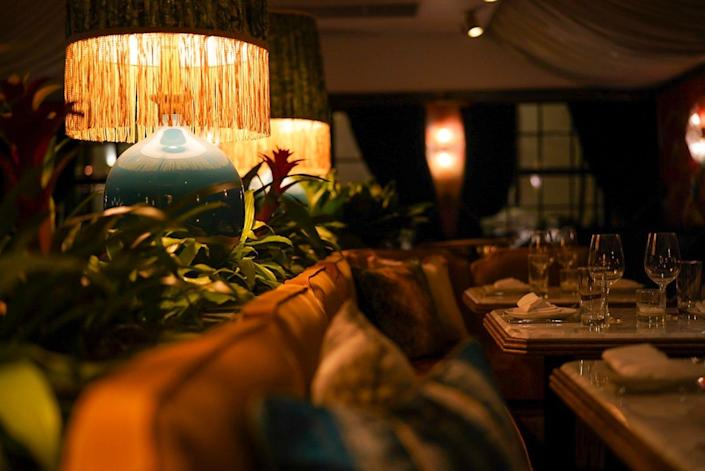 Sculptural lamps set the mood inside Olivetta's charming DIning Room area.