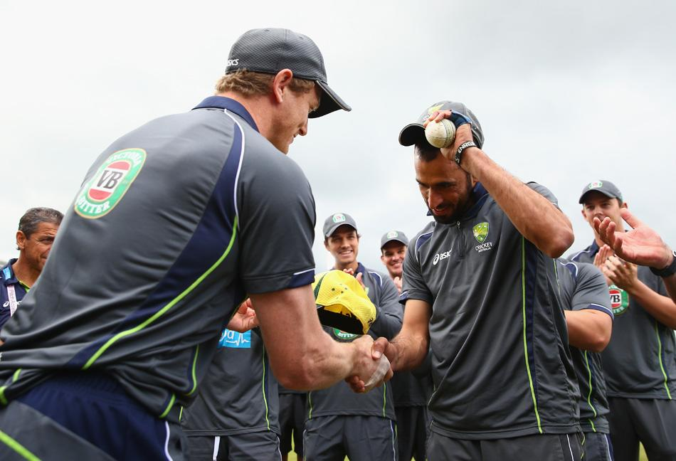 Fawad Ahmed of Australia is awarded his first cap by George Bailey of Australia during the 1st NatWest Series T20 match between England and Australia at Ageas Bowl on August 29, 2013 in Southampton, England.  (Photo by Paul Gilham/Getty Images)