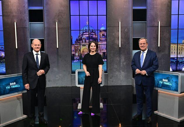 Top candidates for the upcoming German general elections (L-R) Olaf Scholz of the Social Democrats SPD, Annalena Baerbock of Germany's Greens (Die Gruenen) and Armin Laschet of the conservative CDU/CSU party union pose for pictures before a