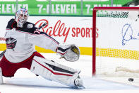 Columbus Blue Jackets goaltender Joonas Korpisalo (70) is unable to stop Dallas Stars right wing Denis Gurianov's shot during the second period of an NHL hockey game Saturday, April 17, 2021, in Dallas. (AP Photo/Sam Hodde)