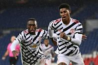 Manchester United forward Marcus Rashford (right) celebrates his winning goal against Paris Saint-Germain
