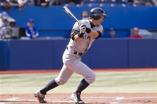 New York Yankees' Ichiro Suzuki, of Japan, singles off Toronto Blue Jays pitcher Ricky Romero during the first inning of a baseball game in Toronto, Saturday, Sept. 29, 2012. (AP Photo/The Canadian Press, Chris Young)