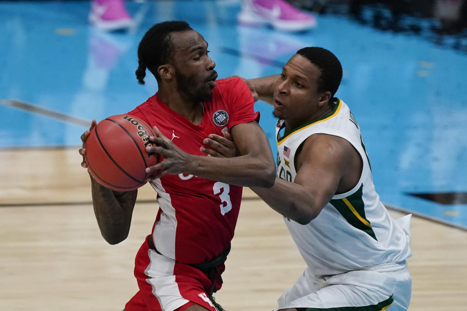Baylor guard Mark Vital, right, tries to steal the ball from Houston guard DeJon Jarreau (3) during the first half of a men's Final Four NCAA college basketball tournament semifinal game, Saturday, April 3, 2021, at Lucas Oil Stadium in Indianapolis. (AP Photo/Michael Conroy)