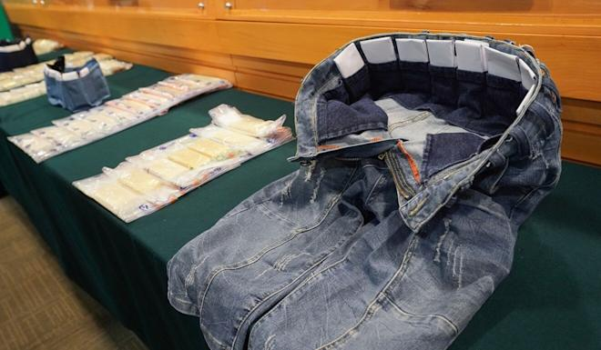 Specially crafted pockets inside a pair of jeans allowed one man to carry 20 gold bars on his person. Photo: SCMP