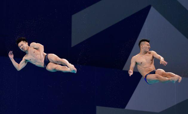 Jul 28, 2021; Tokyo, Japan; Sho Sakai and Ken Terauchi (JPN) in the men's 3m springboard synchronized diving competition during the Tokyo 2020 Olympic Summer Games at Tokyo Aquatics Centre. Mandatory Credit: Grace Hollars-USA TODAY Sports (Photo: Grace Hollars / USA TODAY Sports/Reuters)