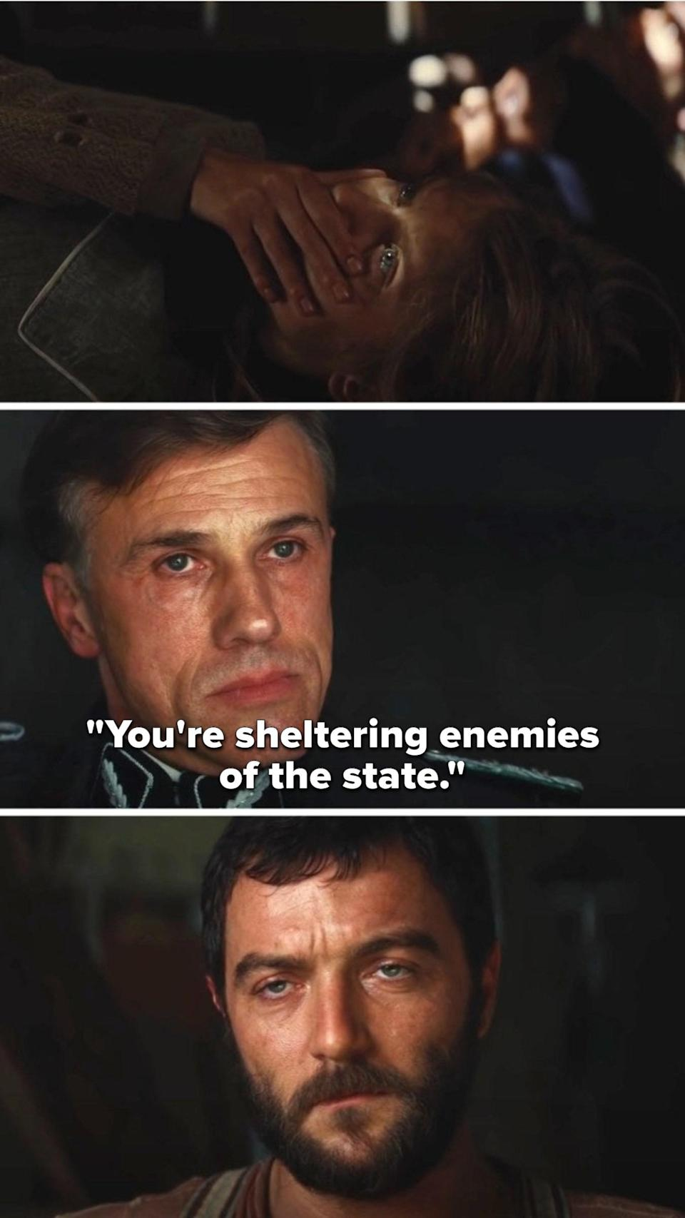 """Hans Landa says""""You're sheltering enemies of the state"""" to the farmer as the Jewish family hides below the floorboards"""
