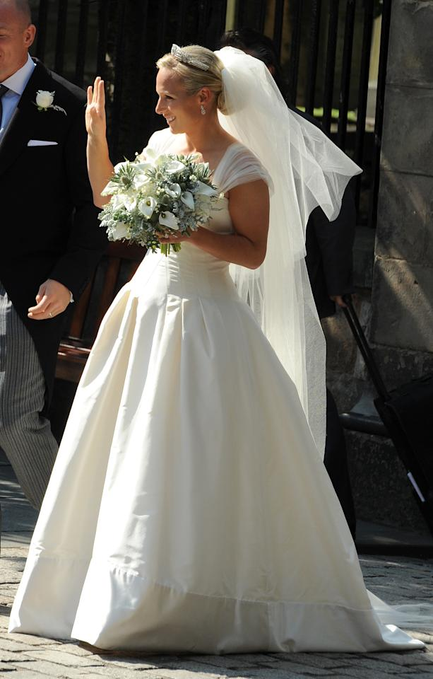 <p>Zara wore an ivory silk satin gown by Belgravia-based designer Stewart Parvin and a tiara given to her by her mother, Princess Anne, for her big day in 2011.<em> [Photo: PA]</em> </p>