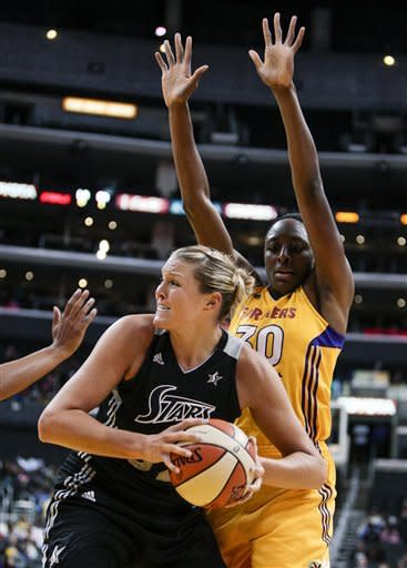 San Antonio Silver Stars center Jayne Appel looks to the basket as she is guarded by Los Angeles Sparks forward Nneka Ogwumike, right, during the first half of a WNBA basketball game, Thursday, Aug. 23, 2012, in Los Angeles. (AP Photo/Bret Hartman)