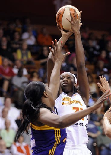 Connecticut Sun's Tina Charles scores two of her team-high 19 points, as Los Angeles Sparks' Jantel Lavender defends during the second half of Los Angeles' 87-81 victory in a WNBA basketball game in Uncasville, Conn., Wednesday, June 13, 2012. (AP Photo/Fred Beckham)