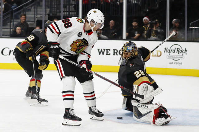 Vegas Golden Knights goaltender Marc-Andre Fleury (29) blocks a shot by Chicago Blackhawks right wing Patrick Kane (88) during the third period of an NHL hockey game Thursday, Dec. 6, 2018, in Las Vegas. (AP Photo/John Locher)