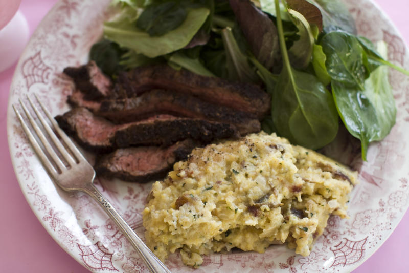 This Jan. 13, 2014 photo shows cocoa butter date polenta and cocoa coffee flank steak in Concord, N.H. (AP Photo/Matthew Mead)