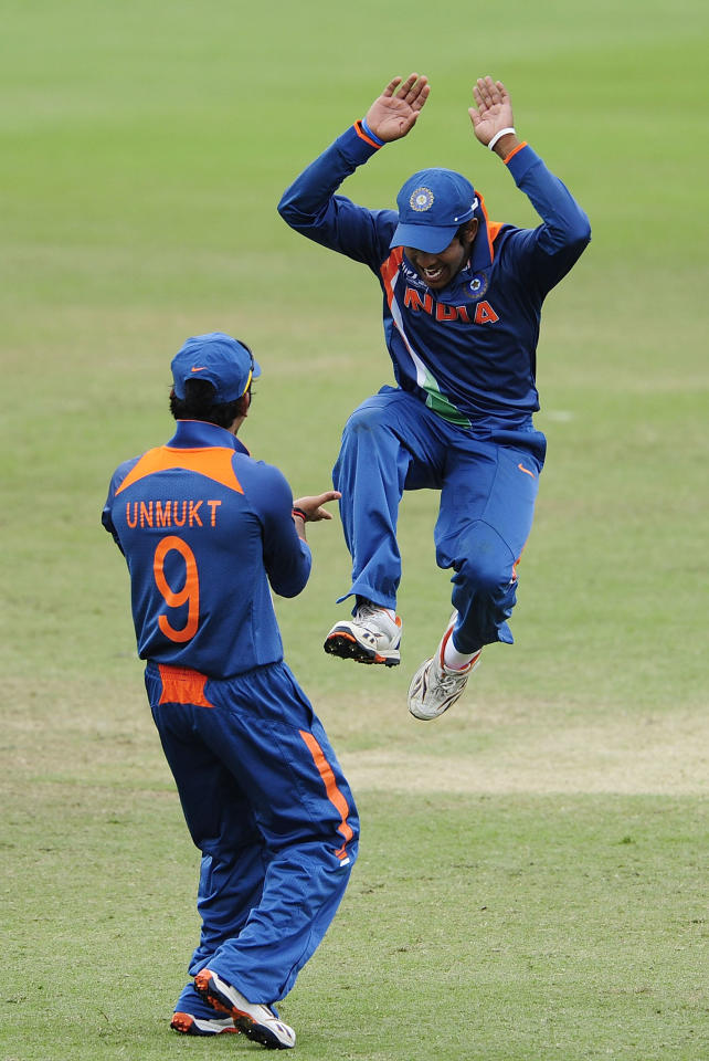 TOWNSVILLE, AUSTRALIA - AUGUST 20:  Aksh Deepnath of India celebrates with Unmukt Chand of India after a Pakistan dismissal during the ICC U19 Cricket World Cup 2012 Quarter Final match between India and Pakistan at Tony Ireland Stadium on August 20, 2012 in Townsville, Australia.  (Photo by Ian Hitchcock-ICC/Getty Images)