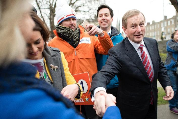 Irish Prime Minister Enda Kenny's Fine Gael may struggle to form a majority for a second term due to a potential collapse in support for junior partners Labour (AFP Photo/Leon Neal)