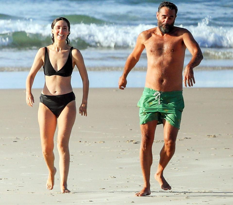 <p>Rose Byrne and Bobby Cannavale go for a swim and hang out at the beach in Byron Bay, Australia on Thursday.</p>
