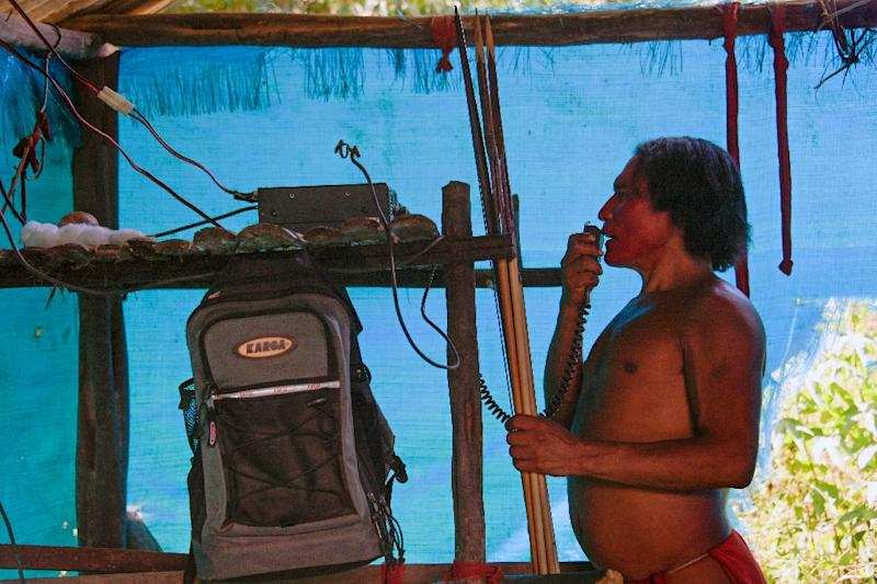 A Waiapi man uses a solar amateur radio to talk to another village (AFP Photo/Apu Gomes)