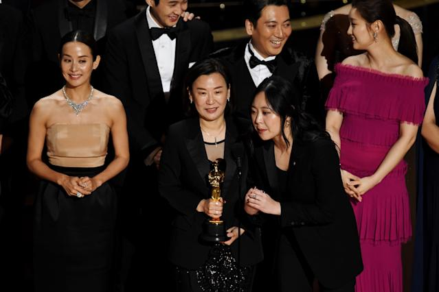 Sharon Choi with <em>Parasite</em> executive producers Min Heoi Heo and Miky Lee accepting the Best Picture award for <em>Parasite</em> at the 92nd Annual Academy Awards. (Photo: Kevin Winter/Getty Images)