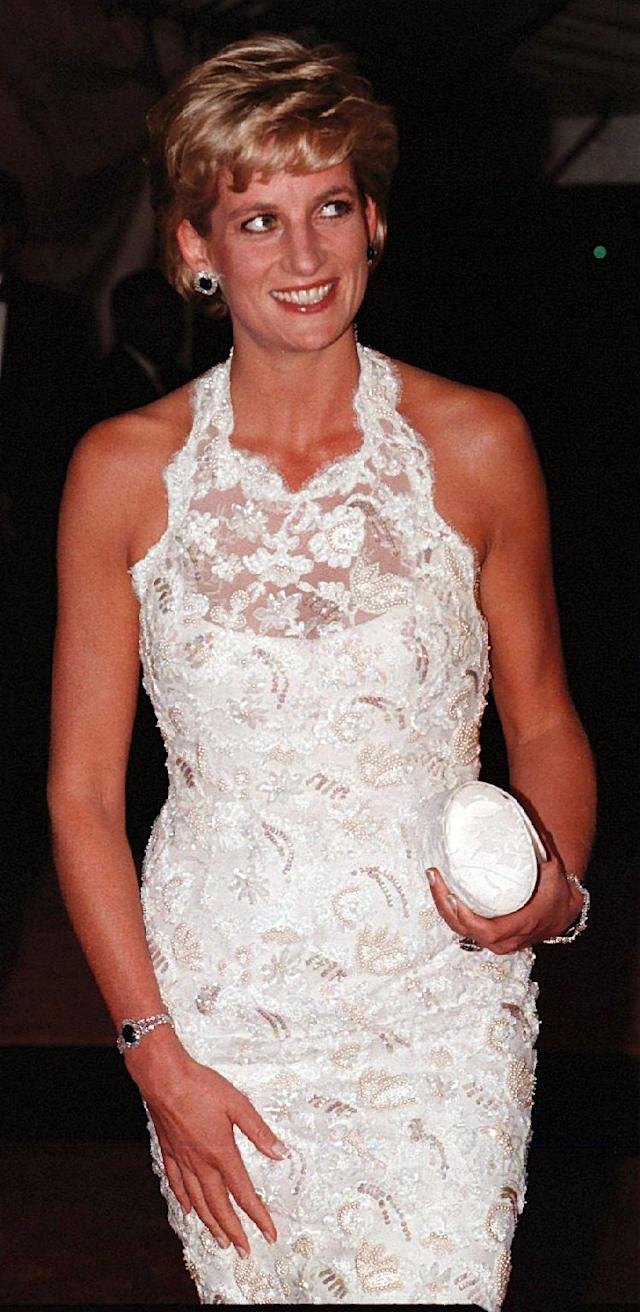 <p>Princess Diana is pictured wearing the earrings and bracelet from the Sapphire Suite. However, at a gala dinner in Washington in 1996, Diana donned the set with another bracelet that was rumored to be a gift from Dodi Al Fayed. (Photo: PA) </p>