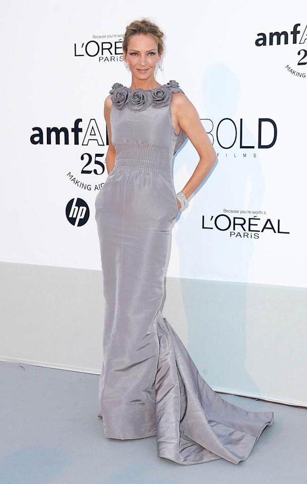 "Uma Thurman delivered my other favorite look at the annual amfAR gala. The statuesque beauty popped a pose upon arriving in a gray Chanel Couture gown, which featured a rosette-enhanced neckline and practical pockets. Dominique Charriau/<a href=""http://www.wireimage.com"" target=""new"">WireImage.com</a> - May 19, 2011"