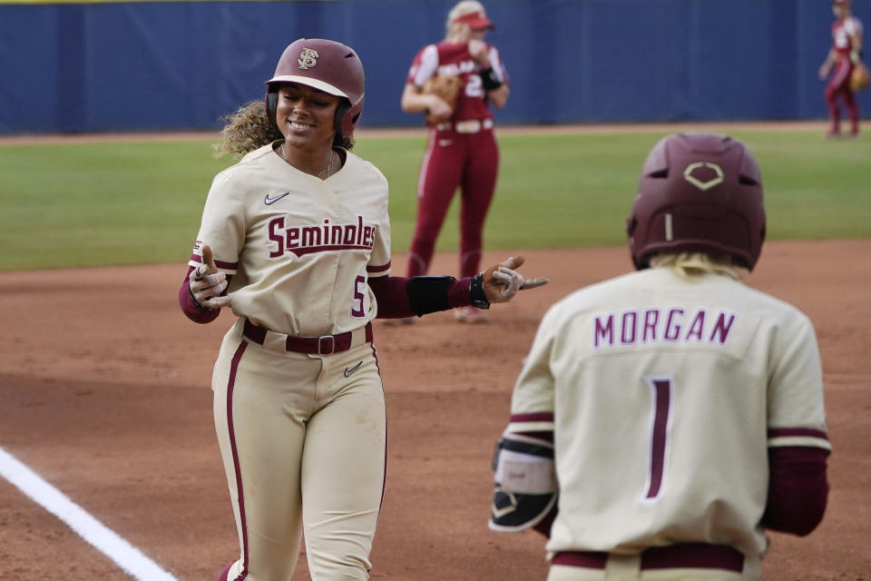 Florida State's Elizabeth Mason (5) gestures as she heads home to score during the first inning of the second game of the NCAA Women's College World Series softball championship series against Oklahoma, Wednesday, June 9, 2021, in Oklahoma City. (AP Photo/Sue Ogrocki)