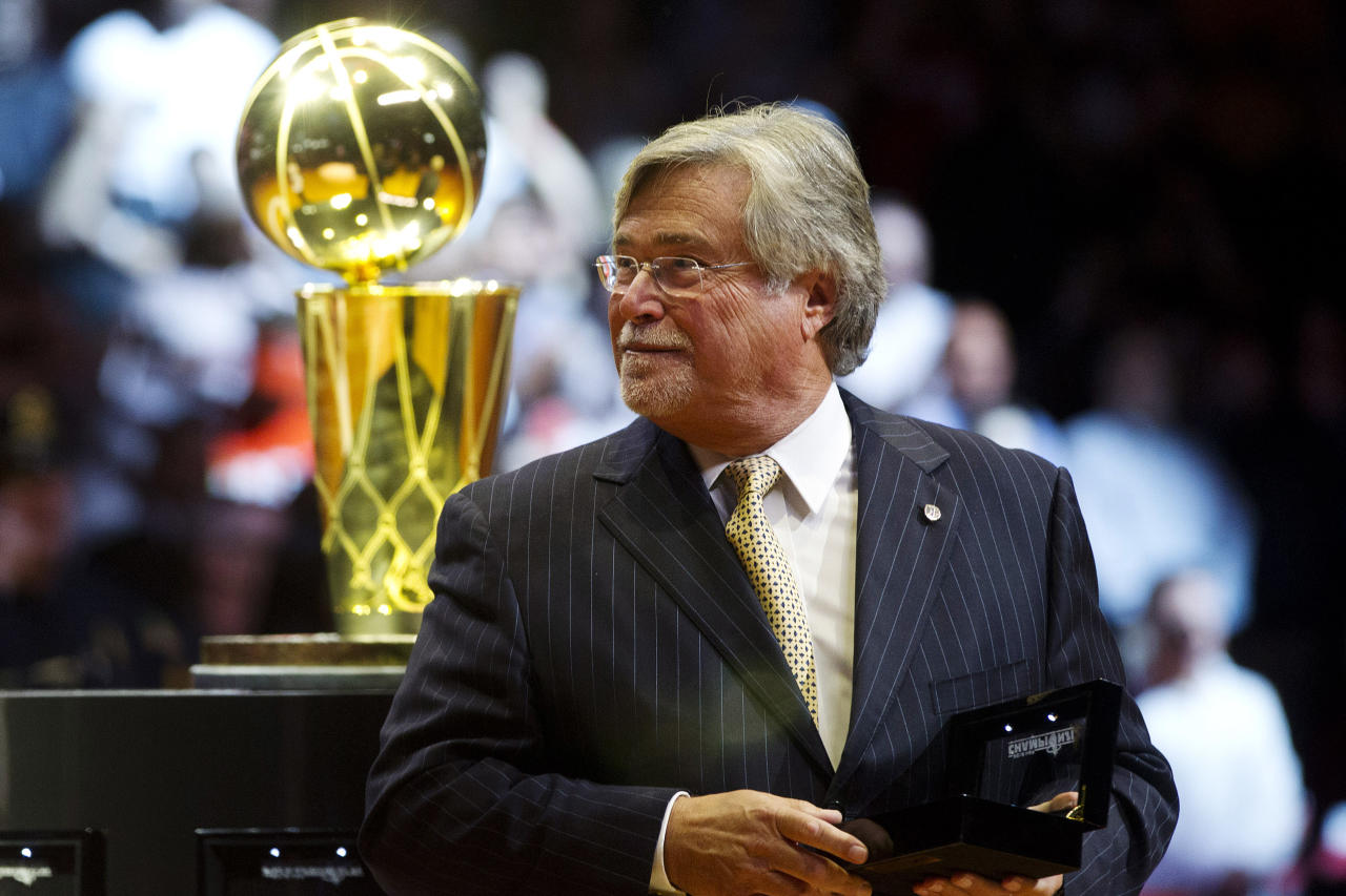 Miami Heat owner Mickey Arison holds his 2012 NBA Finals championship ring during a ceremony before a basketball game against the Boston Celtics, Tuesday, Oct. 30, 2012, in Miami. (AP Photo/J Pat Carter)
