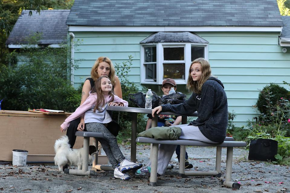 Jessica Rose at her Haverstraw house with her children Madilyn, 7, Masin, 8, and Meadow, 15, Oct. 7, 2021. They have been living in motels since the house was deemed unsafe after flooding damage from the remnants of hurricane Ida.