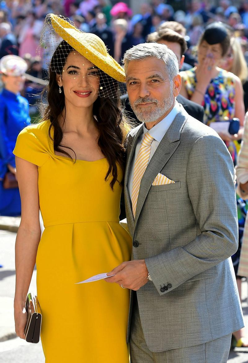 Amal and George Clooney pose together on the day of the royal wedding at St George's Chapel, Windsor Castle, in Windsor, on May 19. (IAN WEST via Getty Images)