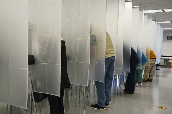 voters fill out ballots during early voting in Cleveland, Ohio on October 6, 2020