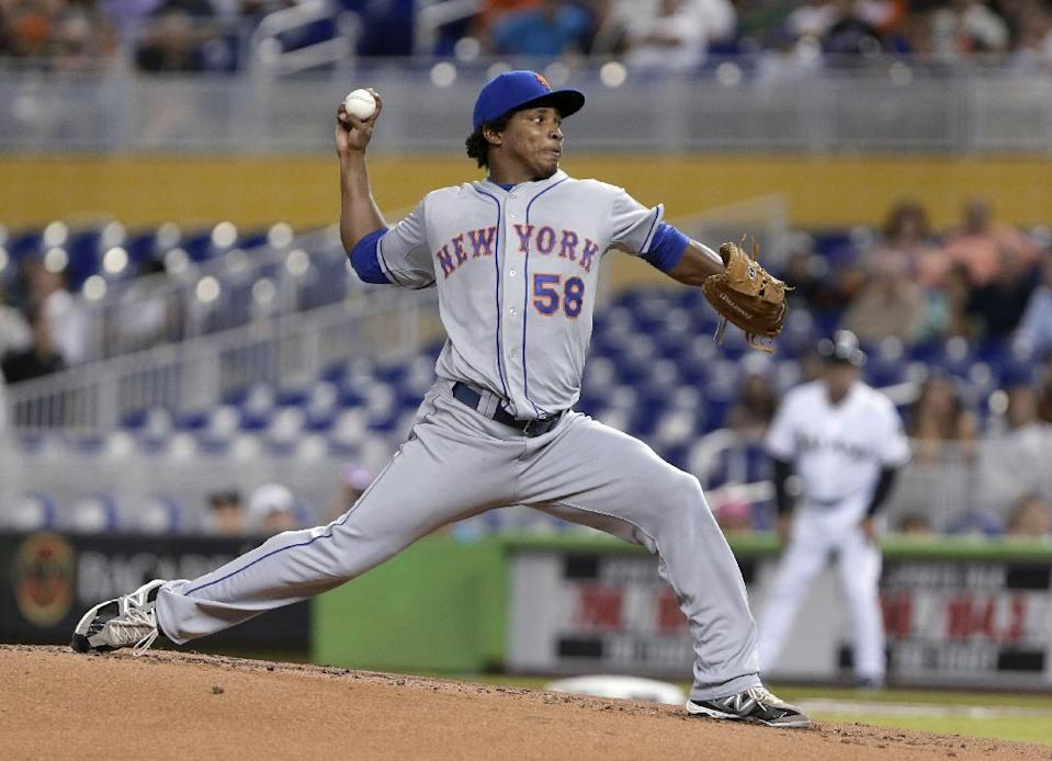 New York Mets' Jenrry Mejia delivers a pitch during the first inning of a baseball game against the Miami Marlins, Wednesday, July 31, 2013 in Miami. (AP Photo/Wilfredo Lee)