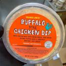 <p>No need to look up a Buffalo chicken dip recipe here! Trader Joe's is stocked with containers full of the dip ready to eat. It's made with white chicken meat, cream cheese, sour cream, cayenne pepper sauce, and shredded Monterey Jack cheese. Now all you need is a couple bags of tortilla chips, and you're set!</p>