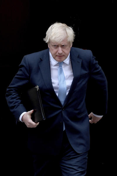 Britain's Prime Minister Boris Johnson walks towards a podium to speak to the media outside 10 Downing Street in London, Monday, Sept. 2, 2019. Johnson says he doesn't want an election amid the Brexit crisis and issued a rallying cry to lawmakers to back him in securing a Brexit deal. (AP Photo/Alberto Pezzali)