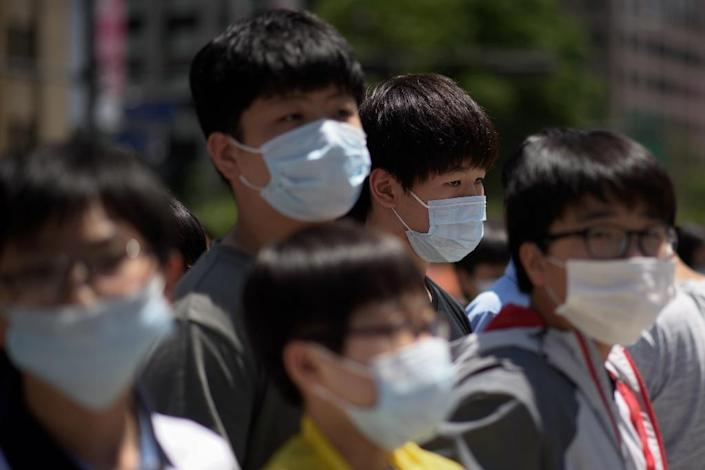 Hundreds more schools have closed on June 4, 2015, in South Korea as officials struggle to ease growing panic over an outbreak of the MERS virus (AFP Photo/Ed Jones)