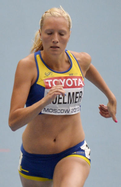 Sweden's Moa Hjelmer runs with her fingernails painted in the colors of the rainbow as she competes in a women's 200-meter heat at the World Athletics Championships in the Luzhniki stadium in Moscow, Russia, Thursday, Aug. 15, 2013. (AP Photo/Martin Meissner)
