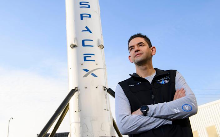 Jared Isaacman, founder and CEO of payments technology company Shift4 Payments is offering three seats on a SpaceX Crew Dragon rocket - PATRICK T. FALLON /AFP