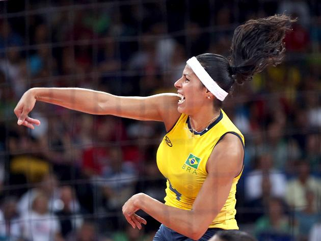 LONDON, ENGLAND - AUGUST 01:  Paula Pequeno #4 of Brazil follows through on a spike in the first half against Korea during Women's Volleyball on Day 5 of the London 2012 Olympic Games at Earls Court on August 1, 2012 in London, England.  (Photo by Elsa/Getty Images)