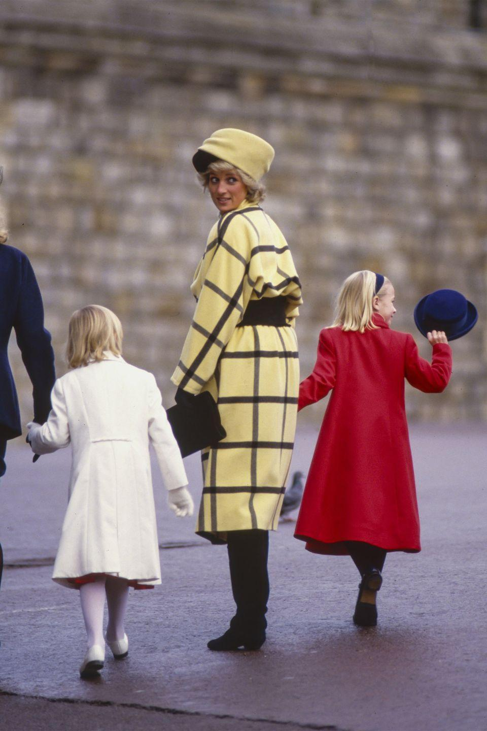 <p>In a yellow dress and hat and black boots and clutch while attending Christmas Day services at St. Georges Chapel at Windsor Castle. </p>