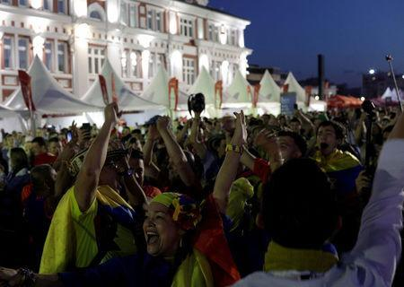 Colombian fans cheer at FIFA Fan Fest in downtown of Saransk, Russia June 18, 2018. REUTERS/Ricardo Moraes