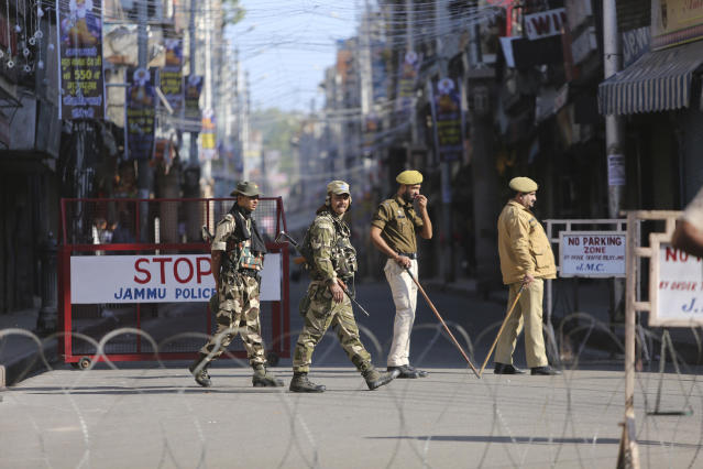 Security officers keep vigil outside Raghunath temple in Jammu city on Saturday, Nov. 9, 2019. State-run broadcaster says India's top court has ruled for a disputed temple-mosque land for Hindus with alternate land to Muslims. The Supreme Court says in a judgment on Saturday that 5 acres (2.02 hecatres) of land be allotted to the Muslim community represented by the Sunni Central Wakf Board in the northern Indian town of Ayodhya where a 16th century mosque was demolished by Hindu hardliners in 1992. (AP Photo/Channi Anand)