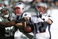 New York Jets outside linebacker Quinton Coples (98) knocks the ball away from New England Patriots quarterback Tom Brady (12) during the second half of an NFL football game Sunday, Oct. 20, 2013, in East Rutherford, N.J. Patriots player at center is unidentified. (AP Photo/Kathy Willens)